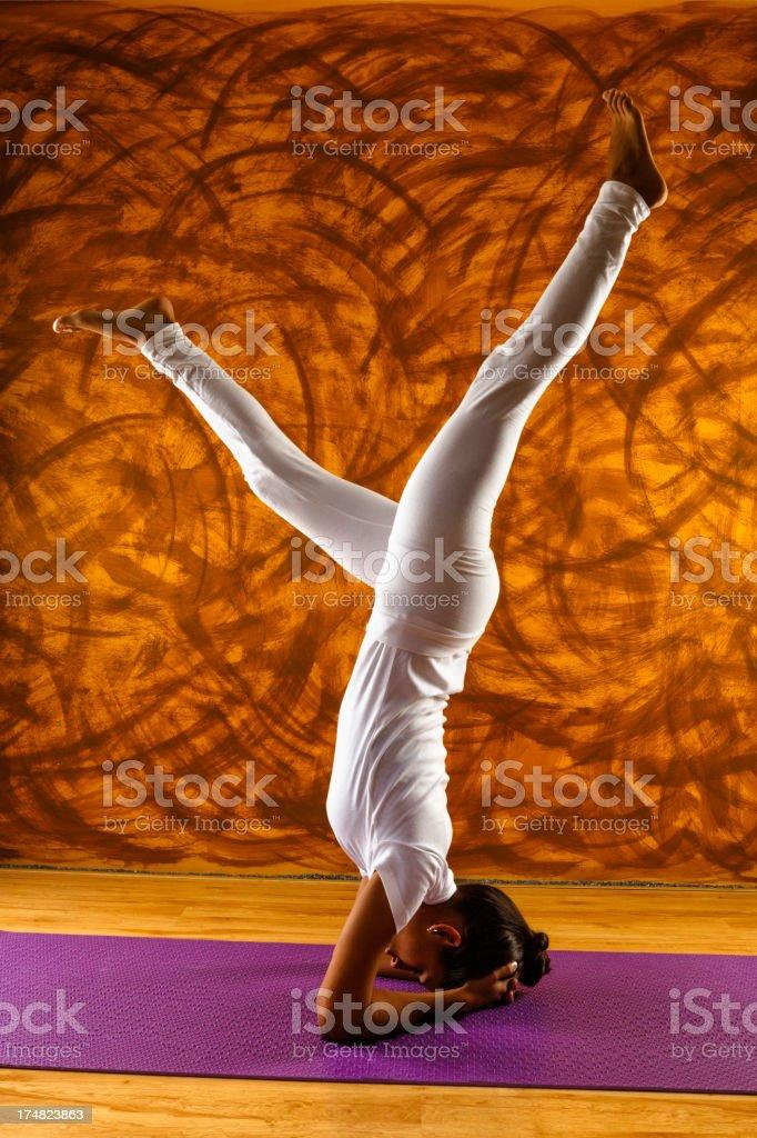Young female yoga instructor doing asana royalty-free stock photo
