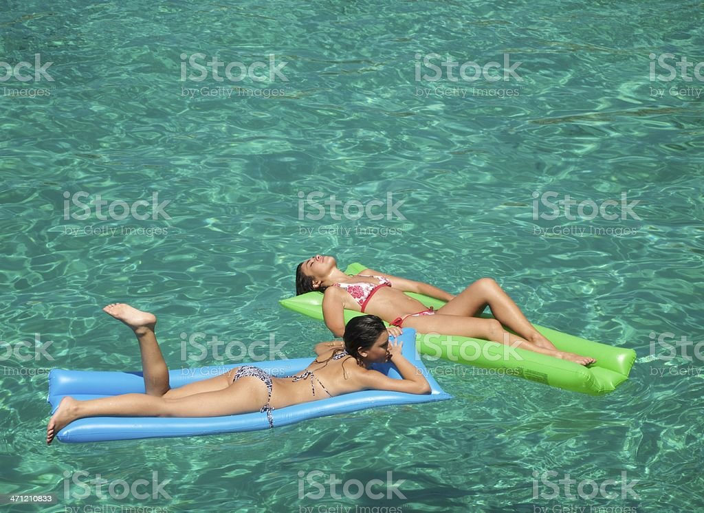 Young Females on Lilos royalty-free stock photo