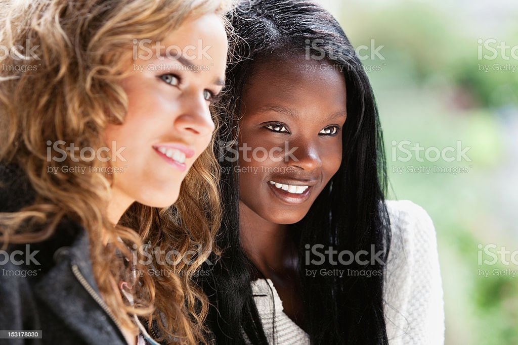 Young females talking to each other in park stock photo
