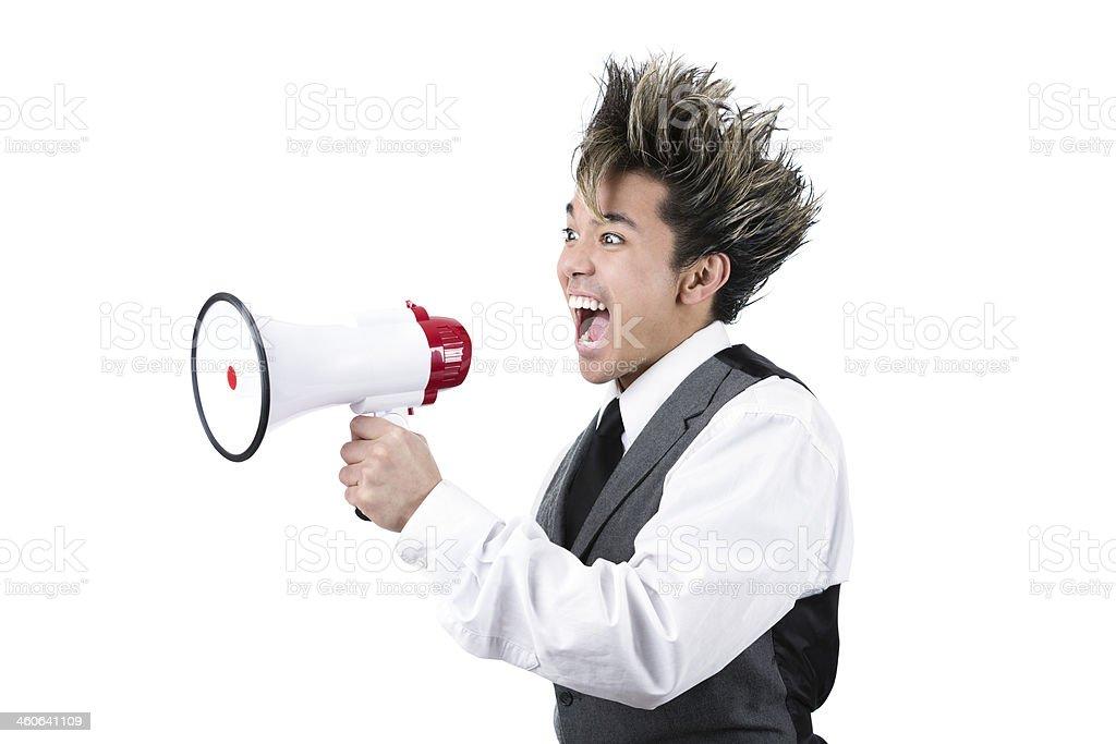 Young filipino man yelling through a megaphone stock photo