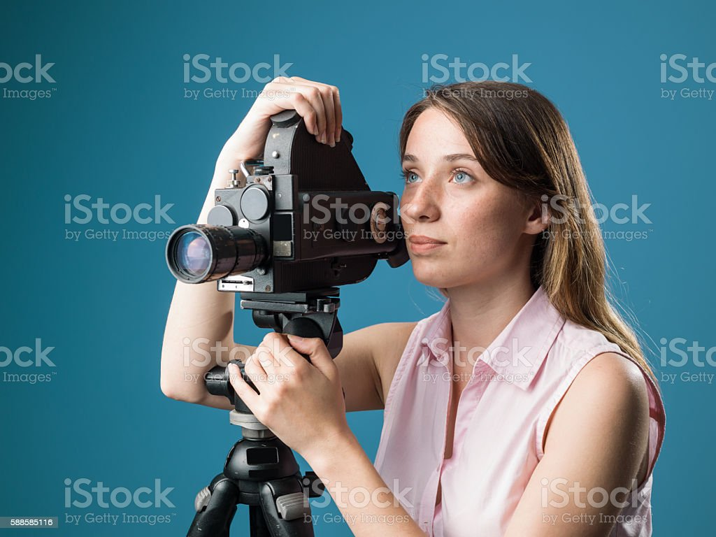 Young Film Director Posing With Her Old Fashioned Camera stock photo
