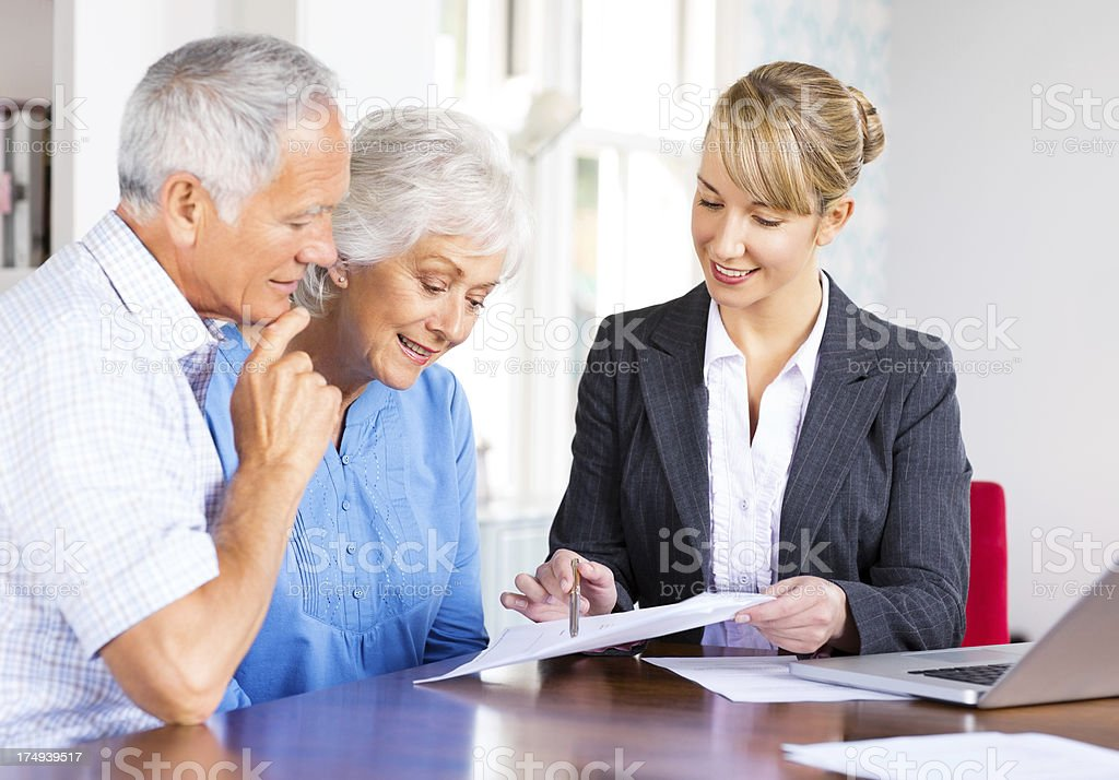 Young financial advisor with senior couple royalty-free stock photo
