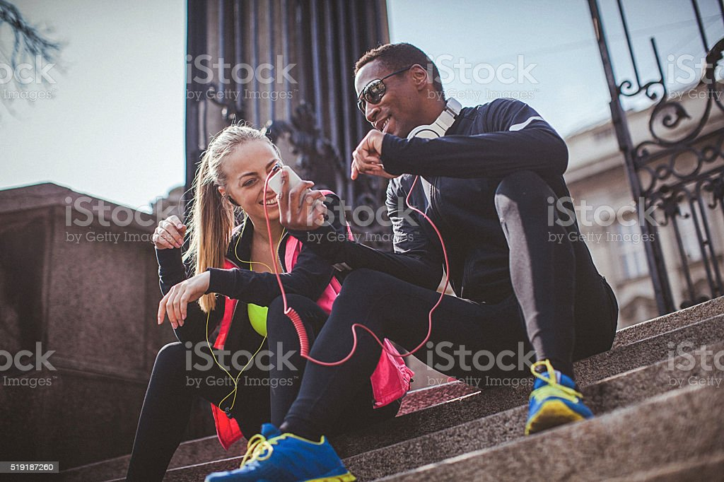 Young fit couple relaxing after the strenuous workout stock photo
