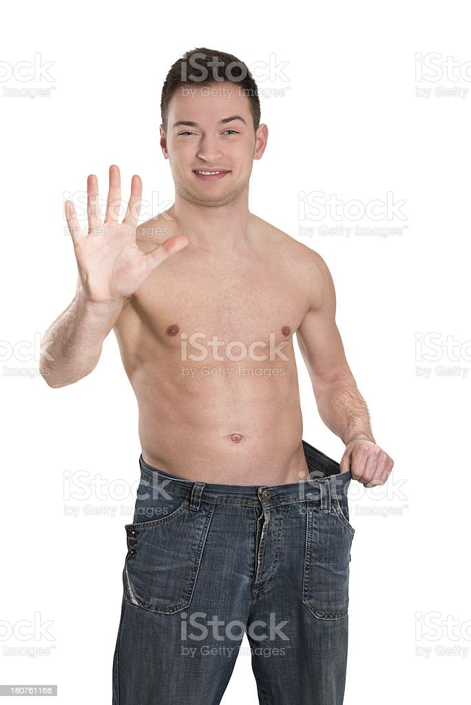 Young Fit Man Showing Amount of Weight He Lost royalty-free stock photo