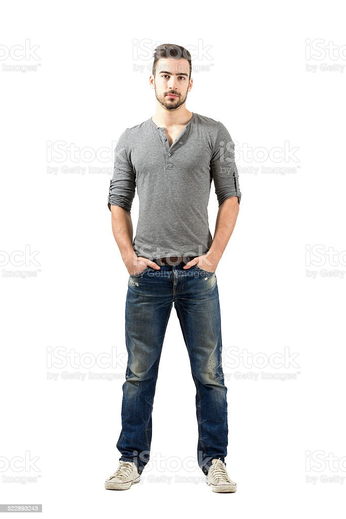 Young fit standing man with hands in pocket stock photo