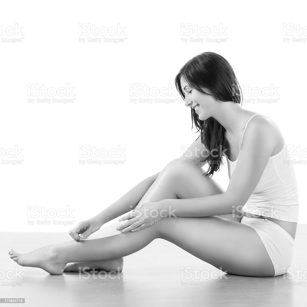 Young fit woman depilate leg royalty-free stock photo