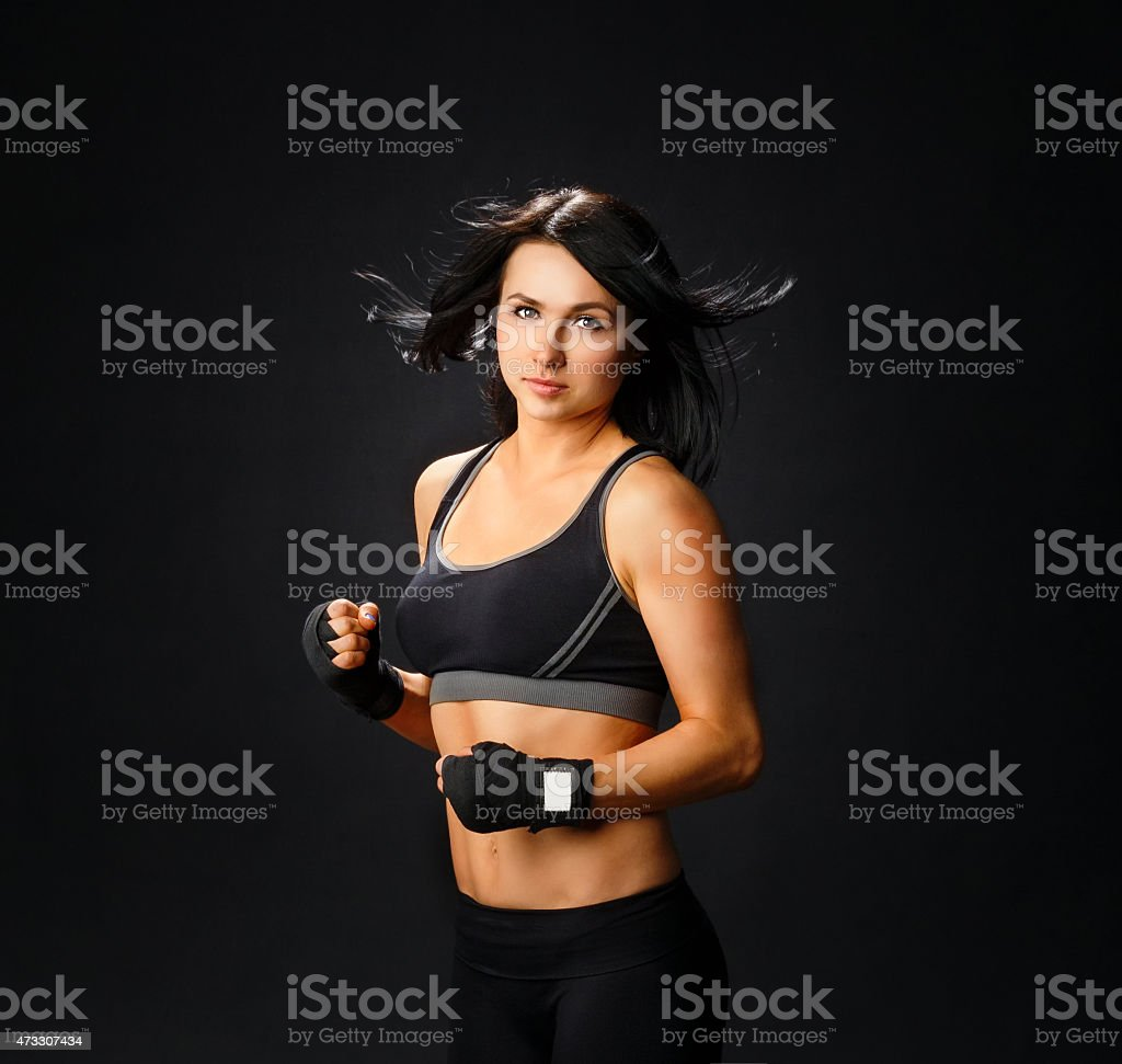 Young fitness woman in gym gloves stock photo