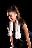 young fitness woman posing with towel