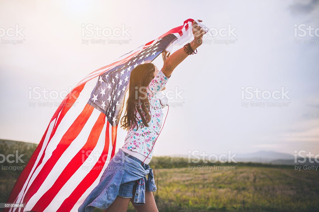 Young Flag Skater girl stock photo