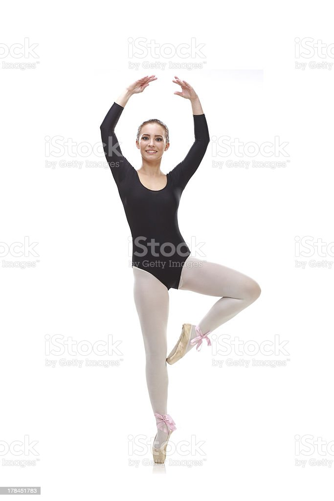 Young flexible ballet dancer standing on tip toes royalty-free stock photo
