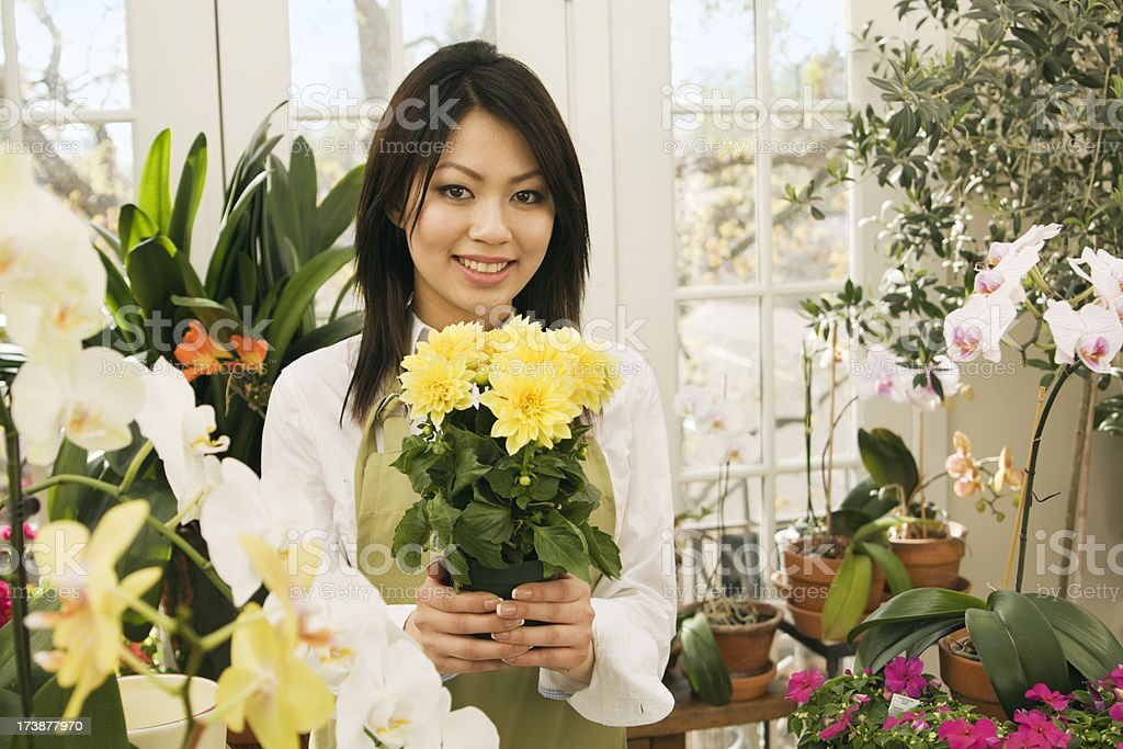 Young Florist Selling Flowers in Her Store royalty-free stock photo