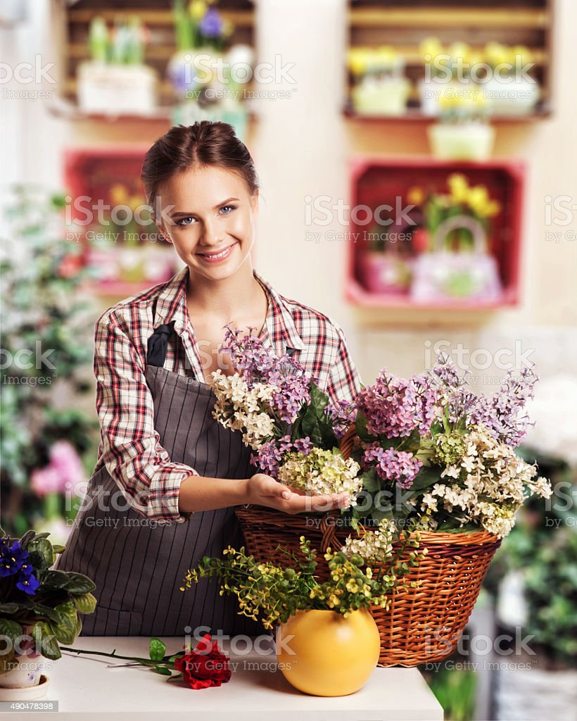 Young florist shop flowers stock photo