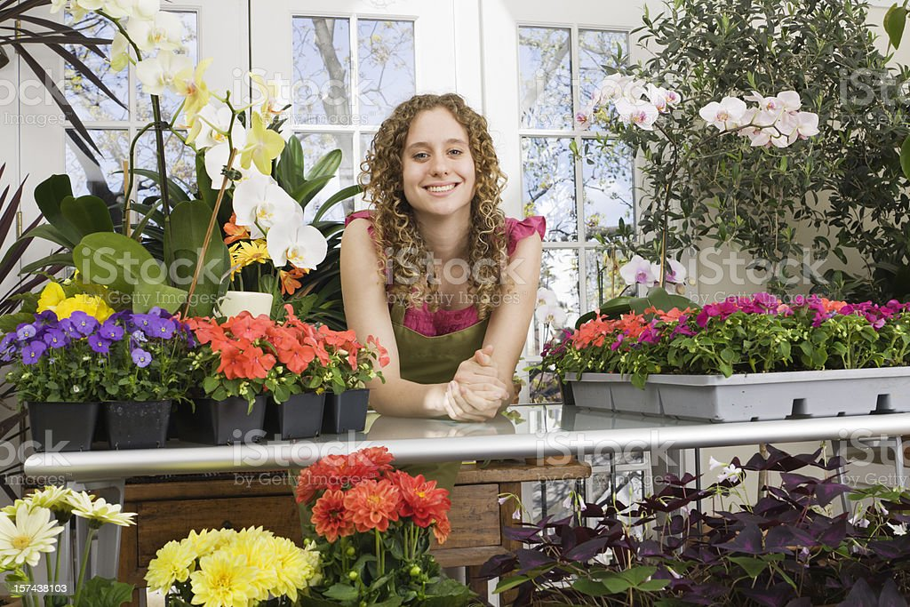 Young Florist Small Business Owner in Flower Shop Retail Store royalty-free stock photo