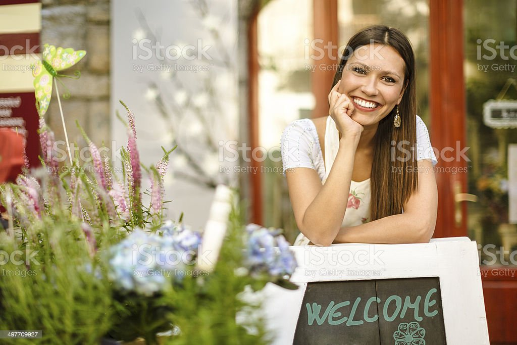Young florist working in her shop stock photo