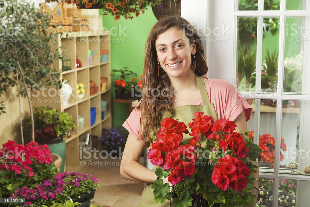 Young Flower Garden Center Sales Person in Front of Store royalty-free stock photo