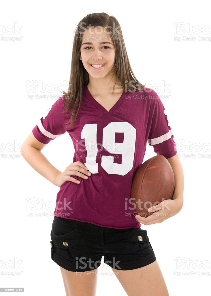 A young football fan wearing a red jersey and holding a ball royalty-free stock photo