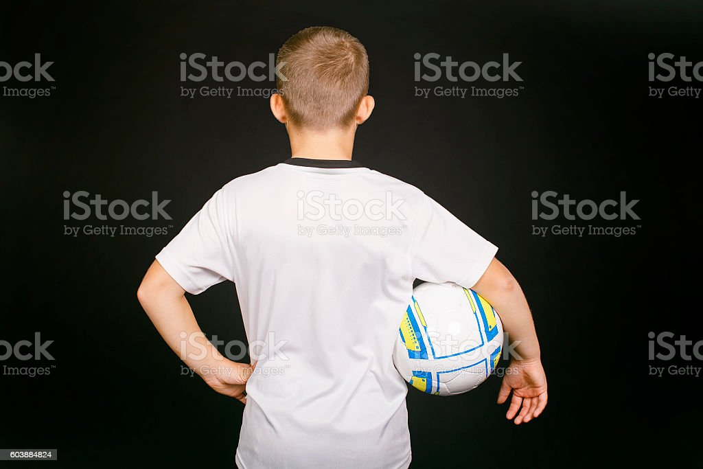 young football player with ball in hand stock photo