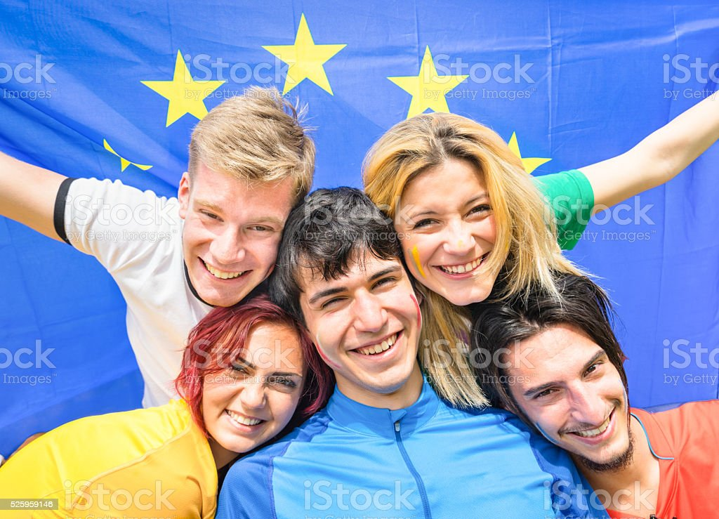 Young football supporter fans cheering with european flag stock photo
