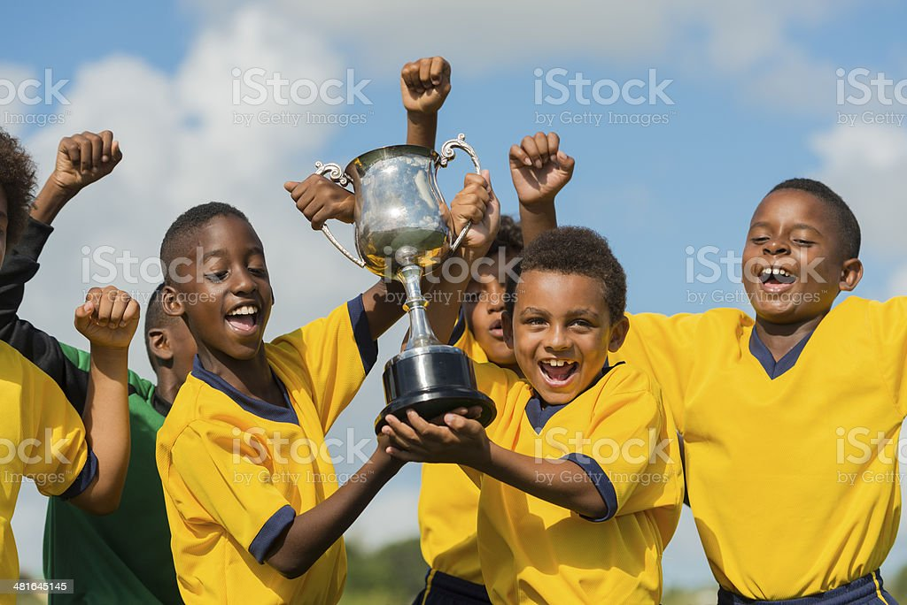 Young Footballers Celebrating stock photo
