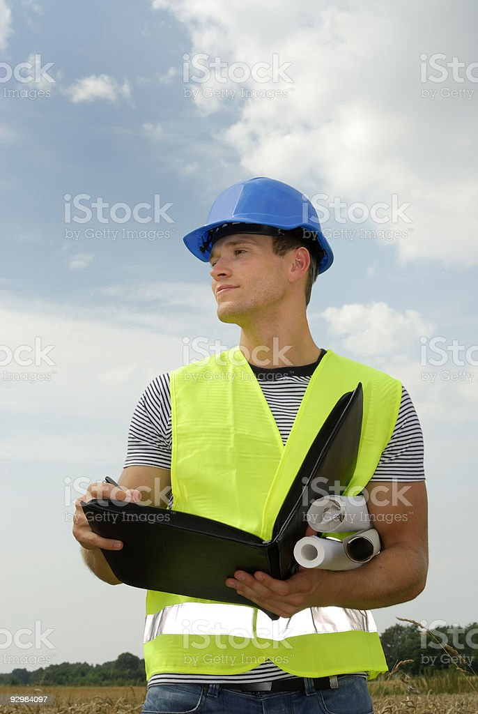 Young foreman with blue helmet royalty-free stock photo