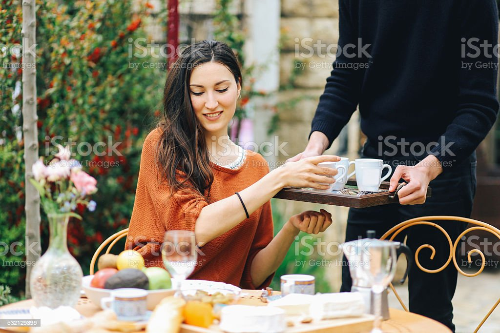 Young French girl eating in the garden home stock photo