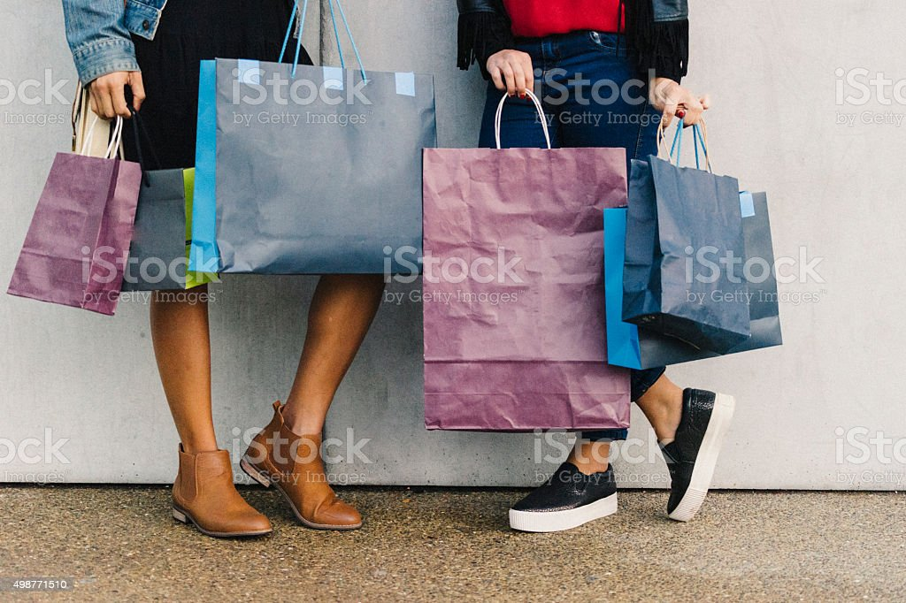 Young friends doing shopping together stock photo