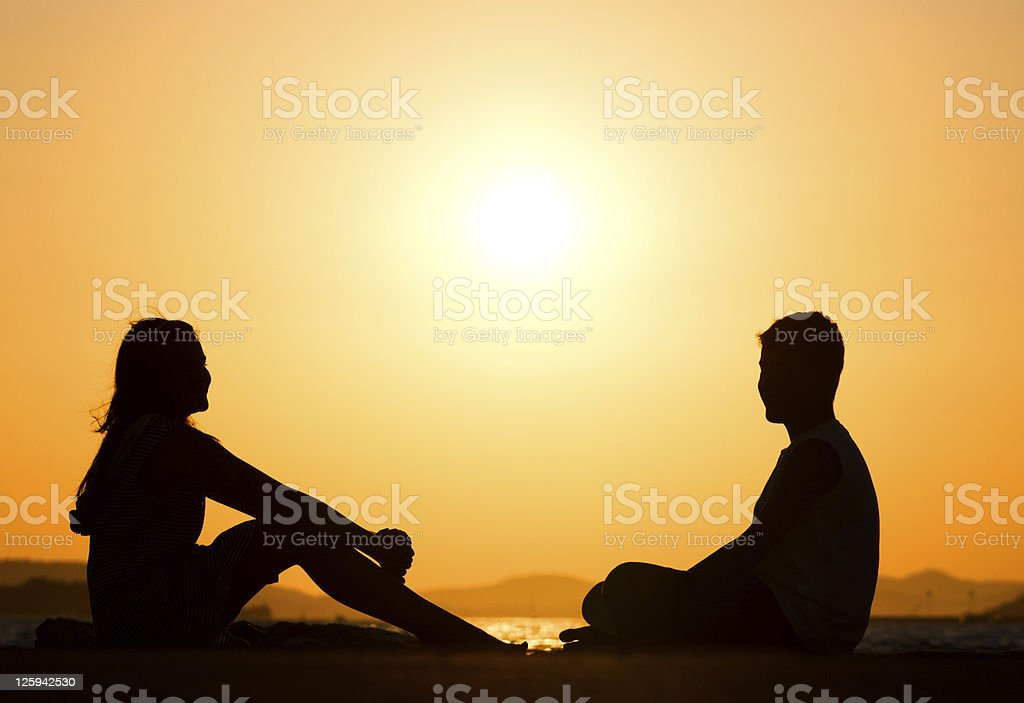 Young friends during sunset royalty-free stock photo