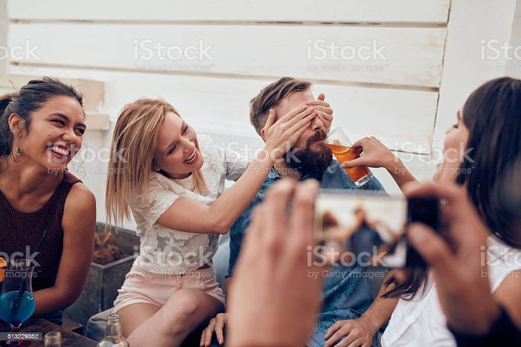 Young friends enjoying at party stock photo