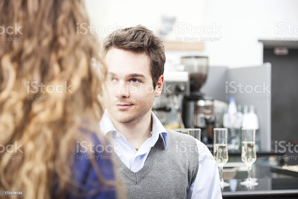 Young friends enjoying wine - Aperitif served in a cafe stock photo