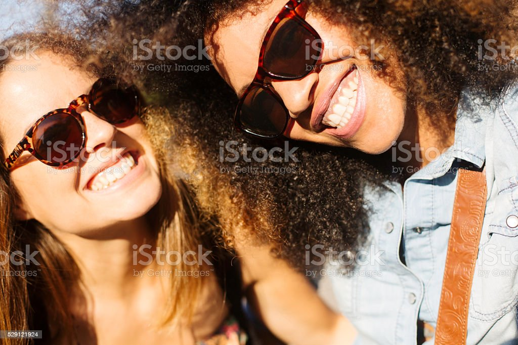 Young friends fooling with smartphone and taking a selfie stock photo