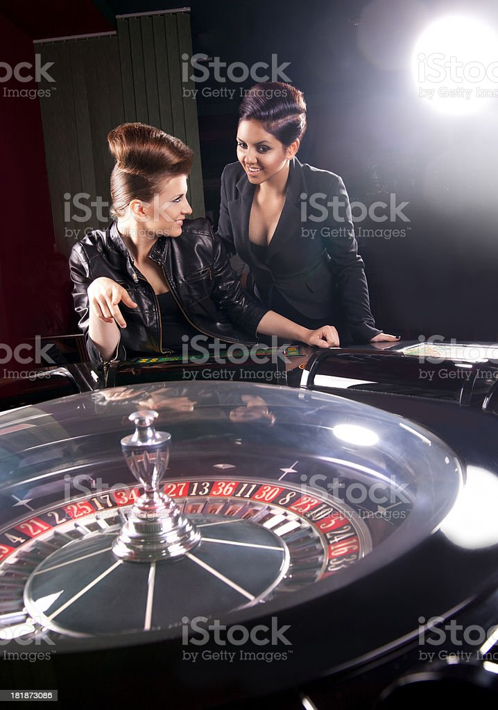 Young friends gambling in the casino royalty-free stock photo