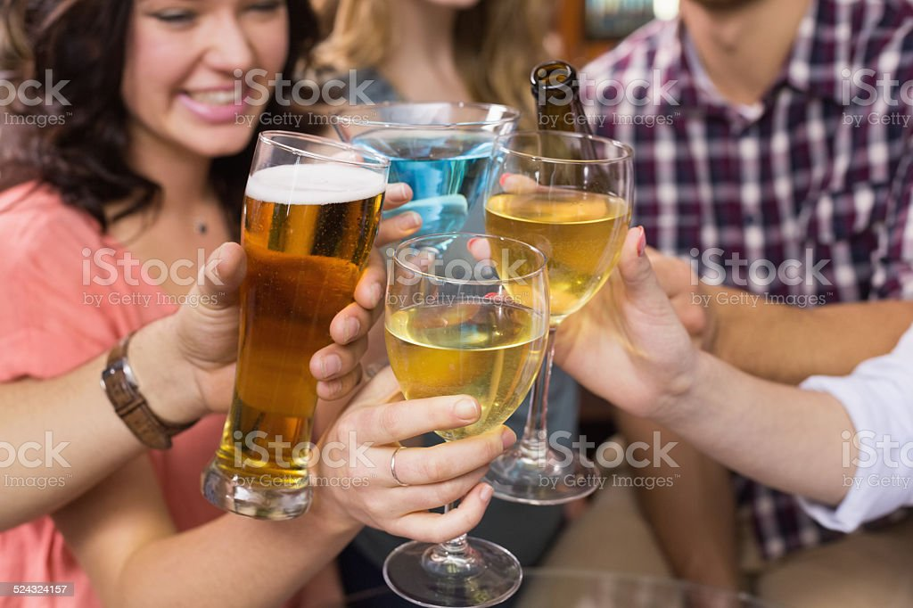 Young friends having a drink together stock photo