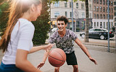 Young friends having a game of basketball