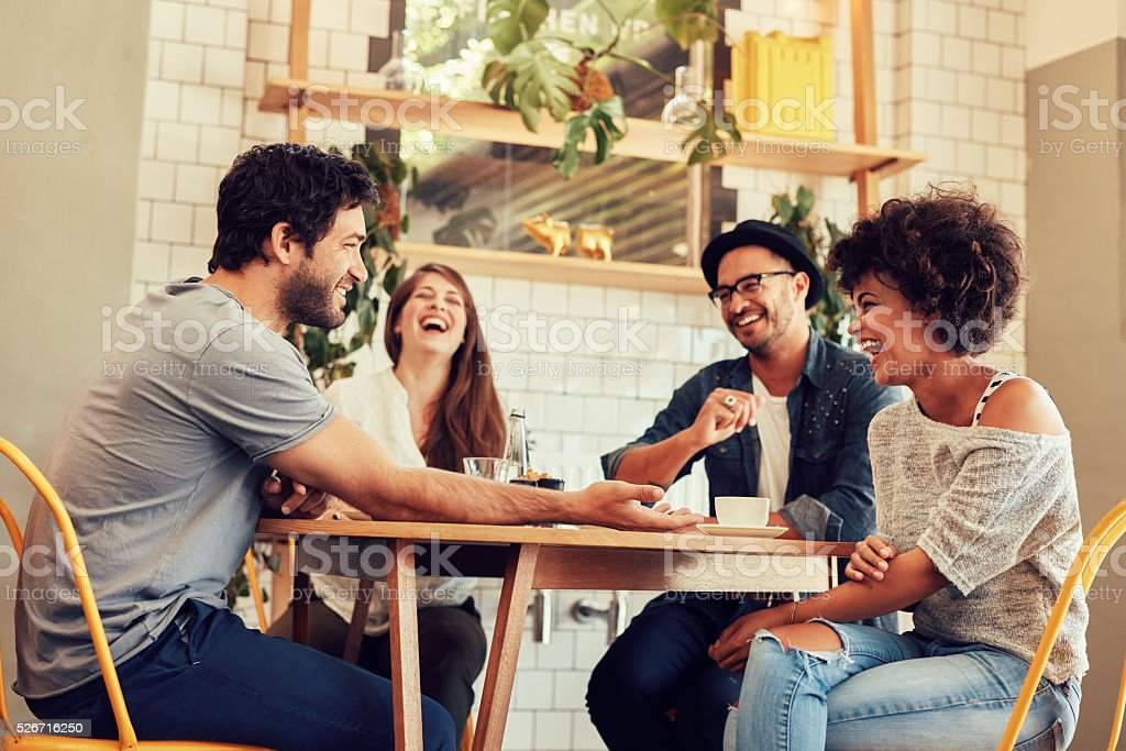 Young friends having a great time in restaurant stock photo
