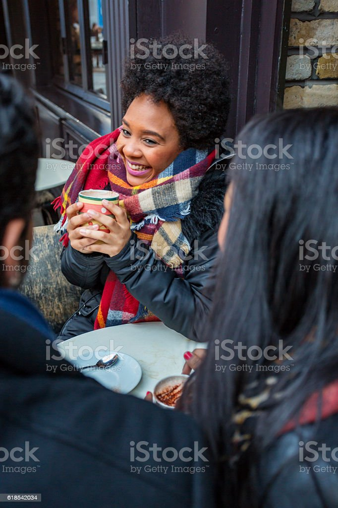 Young Friends Having Fun at a Cafe stock photo