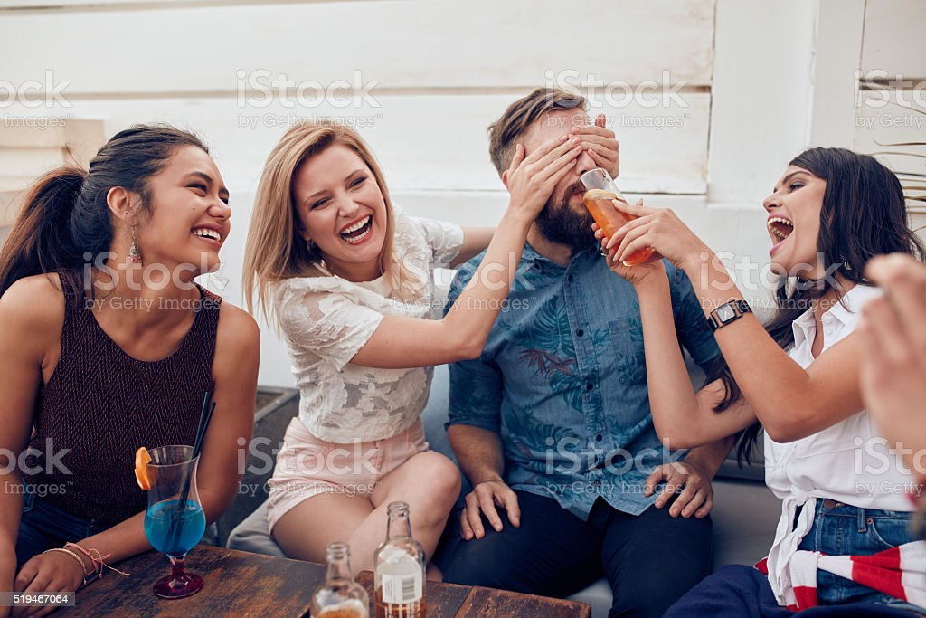 Young friends having fun at party stock photo