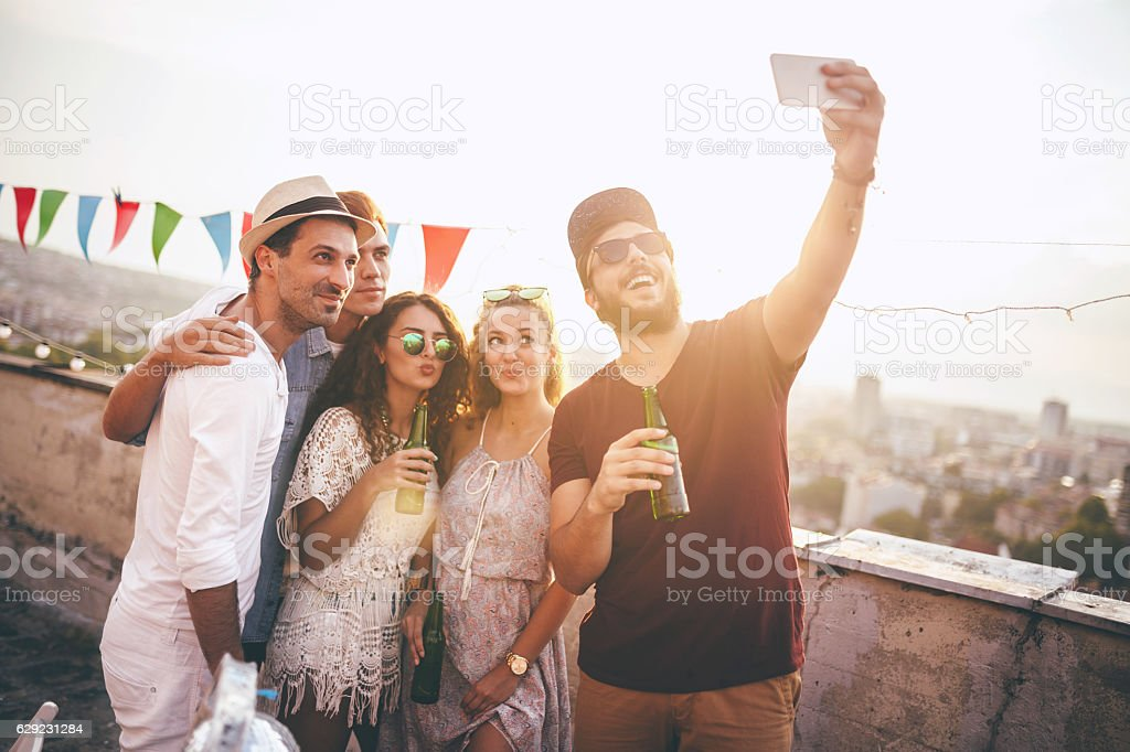 Young friends in a party taking self portrait stock photo