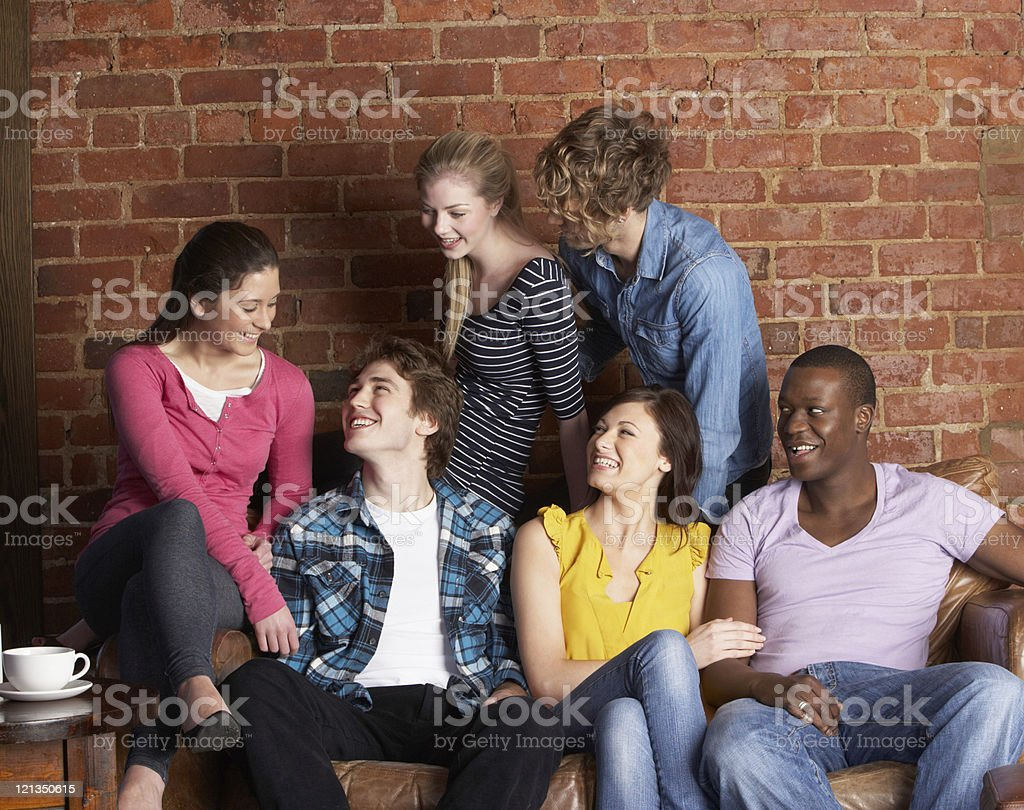 Young friends in café royalty-free stock photo