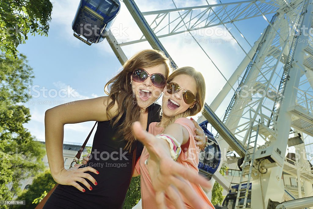 Young friends in the amusement park royalty-free stock photo