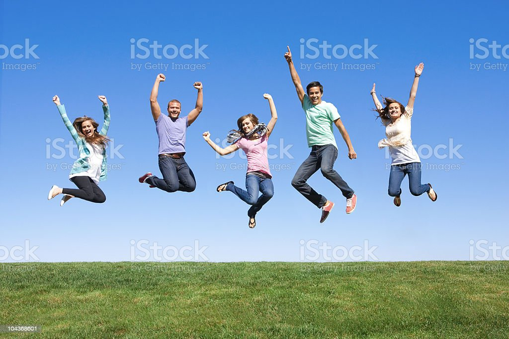 Young Friends Jumping and Having Fun stock photo