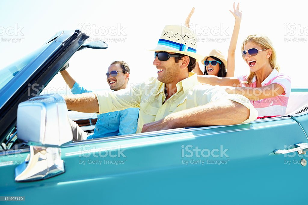 Young friends on a vacation trip in car royalty-free stock photo