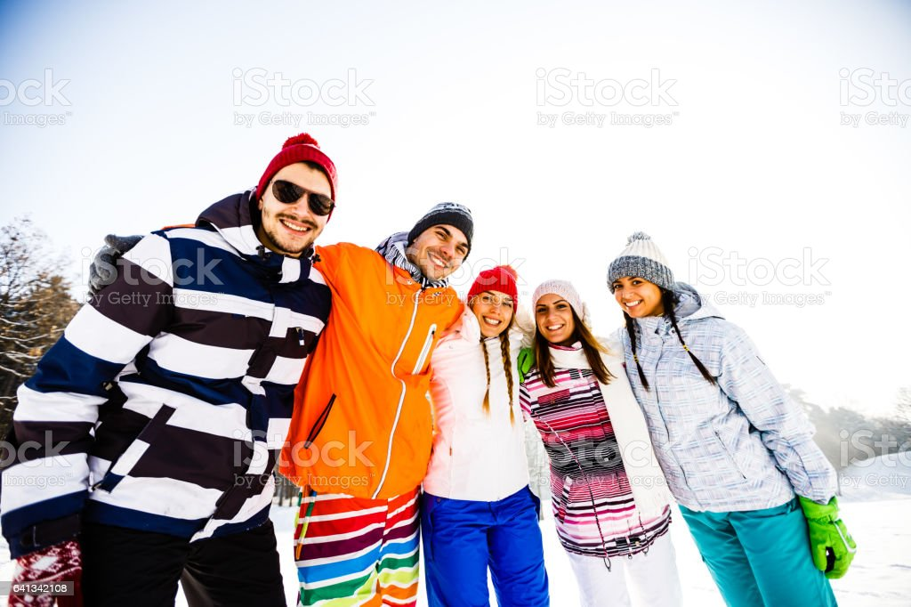 Young friends on snow stock photo