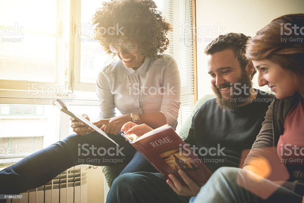 Young friends planning vacations in Rome stock photo
