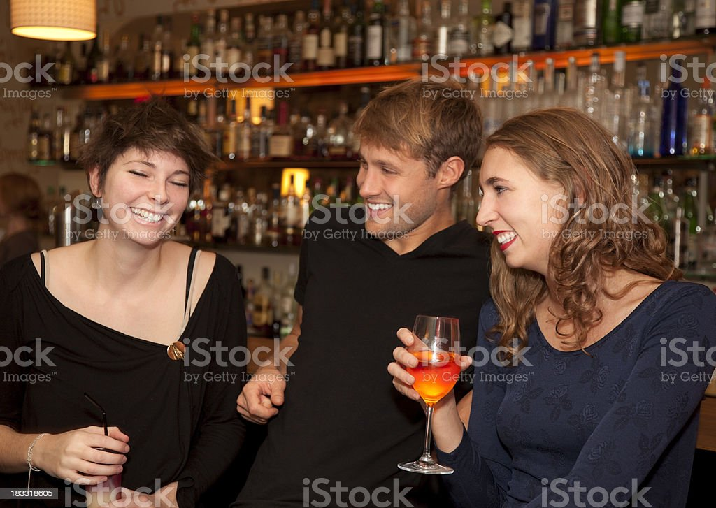 Young Friends Relaxing and Lauging at a Bar after work royalty-free stock photo
