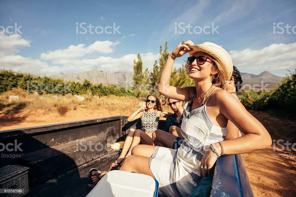 Young friends sitting in a pickup truck stock photo