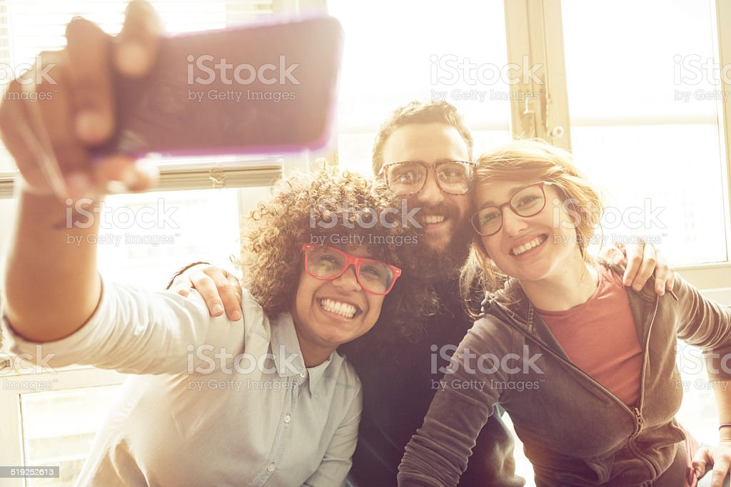 Young friends taking a selfie stock photo