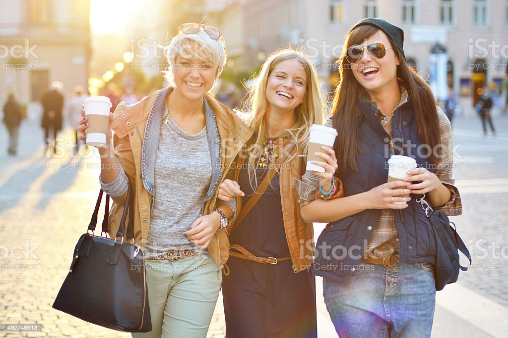 Young friends together drinking coffee in the city stock photo