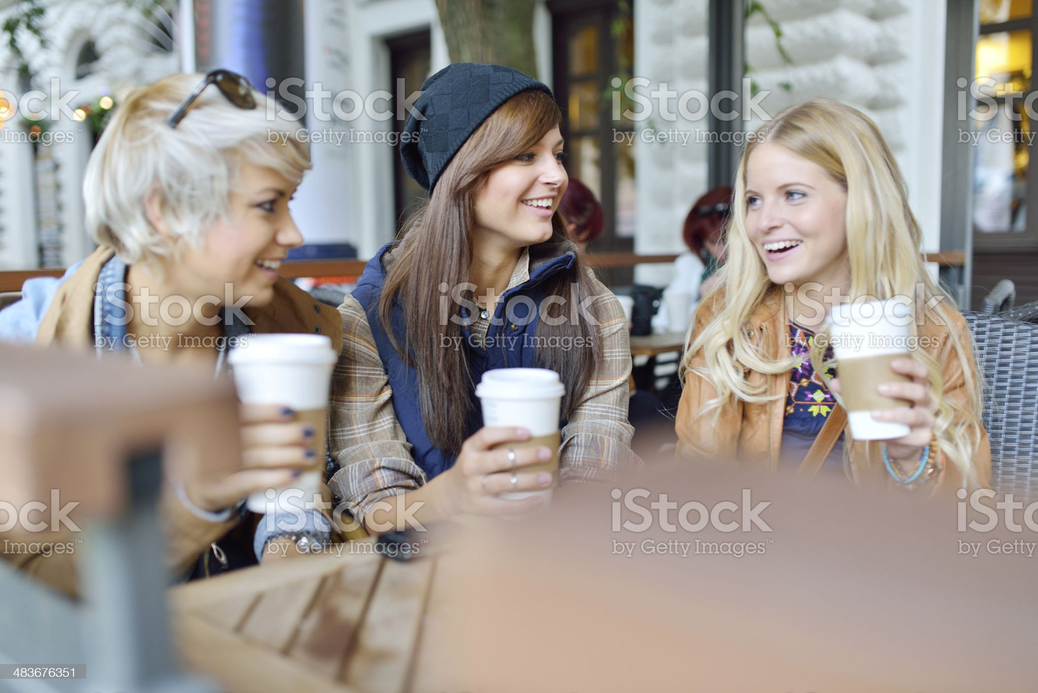 Young friends together drinking coffee in the city royalty-free stock photo