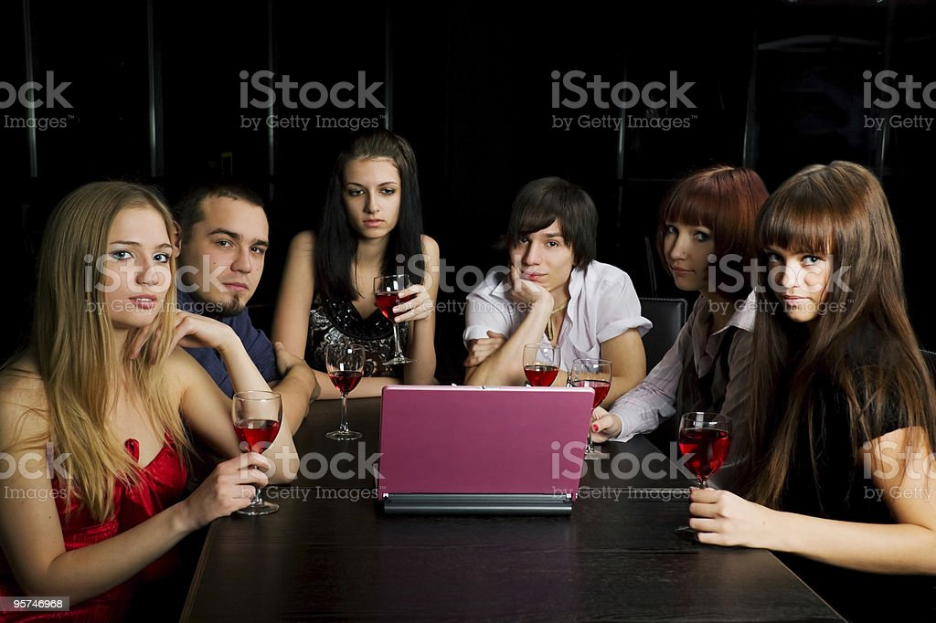 Young friends with laptop in a bar royalty-free stock photo