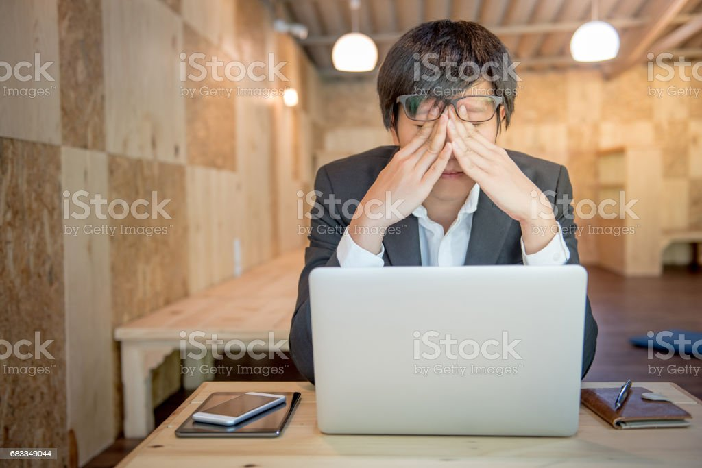 young frustrated stressed business man with laptop stock photo
